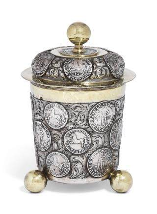 A GERMAN PARCEL-GILT SILVER MUNZBECHER AND COVER