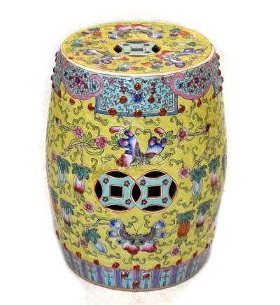 20th Century Chinese porcelain barrel shaped garden seat decorated with stylised foliage on a yellow