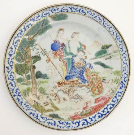 An 18thC Chinese plate decorated with a mythological landscape scene, possibly Minerva,