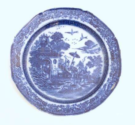 A 19thC blue and white pearlware plate with a chinoiserie scene depicting a figure with a parasol
