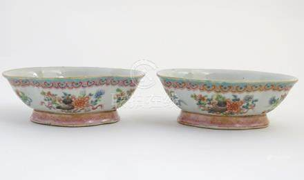 A pair of Chinese famille rose, quatrefoil shaped bowls decorated with scrolling foliage, flowers,
