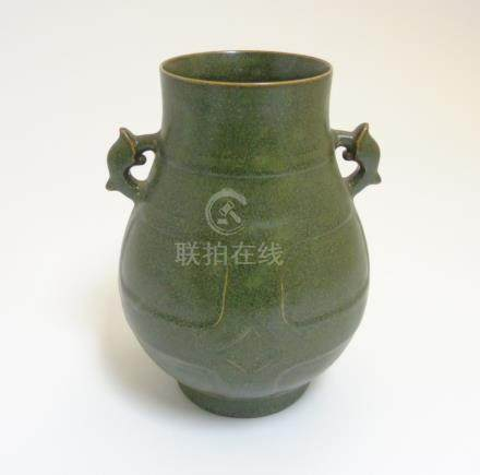 A Chinese tea dust glazed Hu vase, having handles in the form of the tianlu animal,