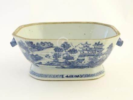 A 19thC Chinese blue and white tureen with cantered corners and twin handles formed as stylised