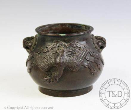 A Chinese bronze vase, Hu, decorated in relief to the exterior with two phoenix's,