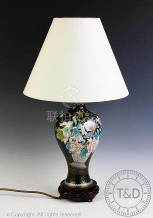 A 20th century cloisonne table lamp, decorated with flowers against a black ground,