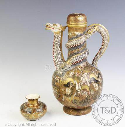 A Japanese Satsuma dragon ewer, Choshuzan, decorated with multiple immortal figures, dragon handle,