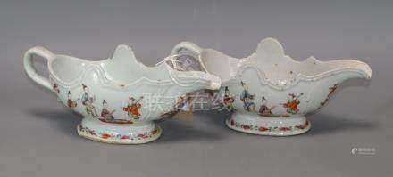 A pair of Chinese Qianlong period famille rose sauceboats length 24cm