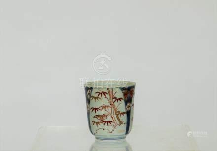 An Imari porcelain tea cup