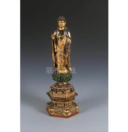 A lacquered-wood standing figure of Amida Nyorai