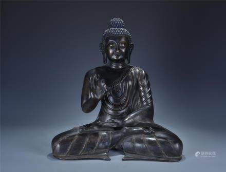 A SEATED BRONZE STATUE OF SAKYAMUNI