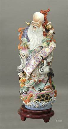 Chinese figure of a wiseman circa 1950 in Famille Rose porcelain