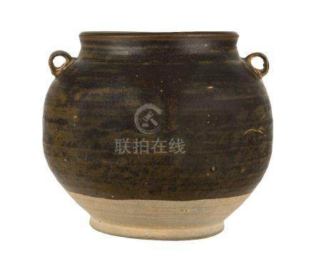 A Chinese grey stoneware jar, Tang dynasty, with wide mouth and two lug handles to shoulders covered