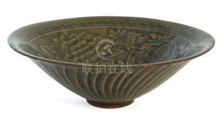 A Chinese Yaozhou conical bowl, carved in low relief to the interior with two entwined flowering