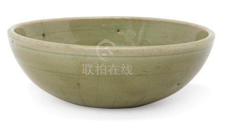 A Chinese Longquan celadon bowl, Ming dynasty, with steep sides and raised central reserve to