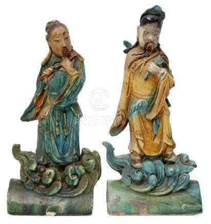 A pair of Chinese pottery figural roof tiles, Ming dynasty, each depicting a Daoist immortal, glazed