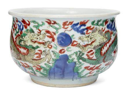 A Chinese porcelain wucai jardiniere, late Ming dynasty, painted to the exterior with with two