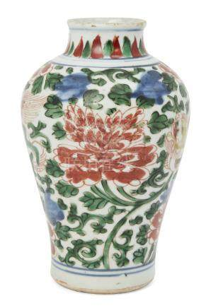 A Chinese porcelain wucai baluster vase, Ming dynasty, 17th century, painted with two Buddhist lions