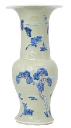 A Chinese porcelain celadon yen yen vase, Kangxi period, painted in underglaze blue and copper red