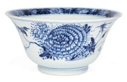 A Chinese porcelain bowl, Kangxi period, painted in underglaze blue to the interior with a floral