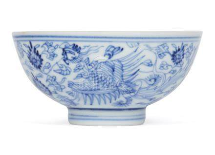 A Chinese porcelain 'Phoenix' tea bowl, Yongzheng mark and of the period, painted in underglaze blue