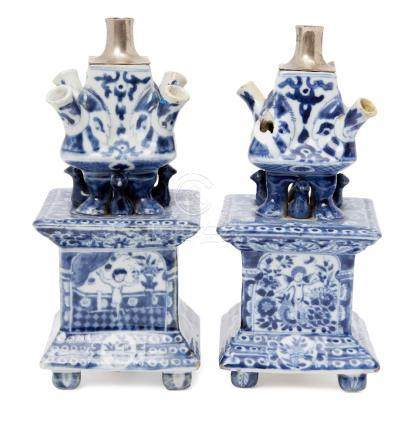 A pair of Chinese porcelain square tulip vases, 18th century, painted in underglaze blue to the main
