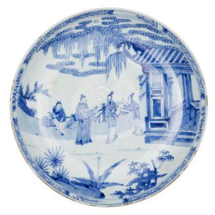 A large Chinese porcelain dish, Yongzheng mark and period, painted in underglaze blue with a scene