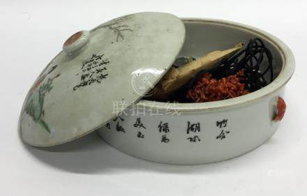 A Chinese bowl and cover decorated with figures an