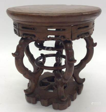 A carved Oriental hardwood vase stand. Approx. 22