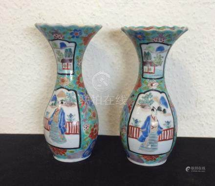 A pair of Chinese blue ground vases decorated with