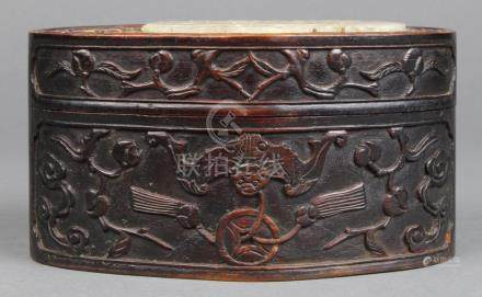 Chinese hardwood lidded box, the oval sectioned lid inset with a hardstone plaque with bat and