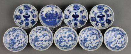 (lot of 9) Chinese blue-and-white porcelain sauce dishes: four decorated with scholar's items and