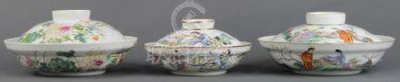(lot of 3) Chinese enameled porcelain lidded tureens, two featuring figures in a garden; the other