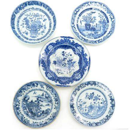 A Diverse Collection of Five Blue and White Plates