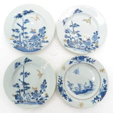 A Collection of Four Blue and White Decor Plates