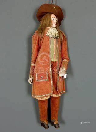 Marionnette de Toone. Figurant un mousquetaire. Tête en bois sculpté. Habits en