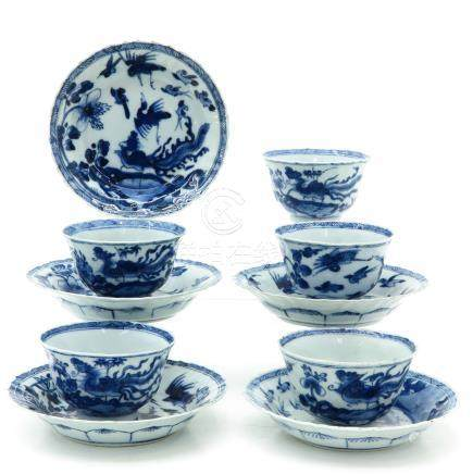 A Series of Five Blue and White Cups and Saucers