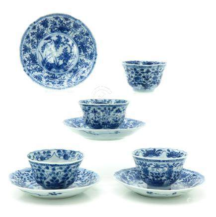 A Series of Four Blue and White Cups and Saucers