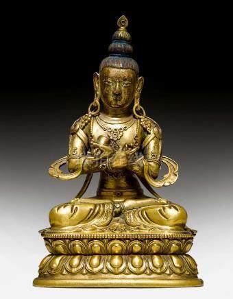 A GILT COPPER REPOUSSE FIGURE OF VAJRADHARA.
