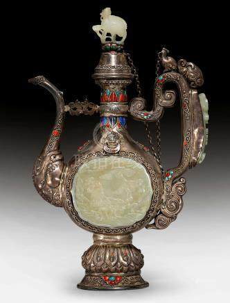 A FINE SILVER EWER DECORATED WITH CELADON JADE CARVINGS.