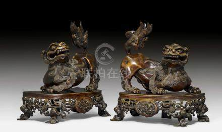 A PAIR OF BRONZE LIONS.