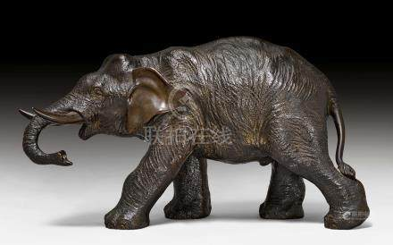 A PACING BRONZE ELEPHANT.