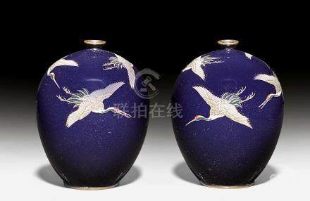 A PAIR OF SMALL ENAMEL COISONNÉ VASES DEPICTING FLYING CRANES.