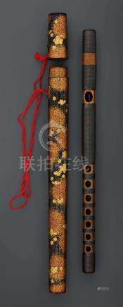 A BAMBOO FLUTE (SHAKUHACHI) WITH A LACQUERED CASE.