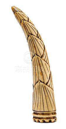 A STAG ANTLER NETSUKE OF A BAMBOO SHOOT.