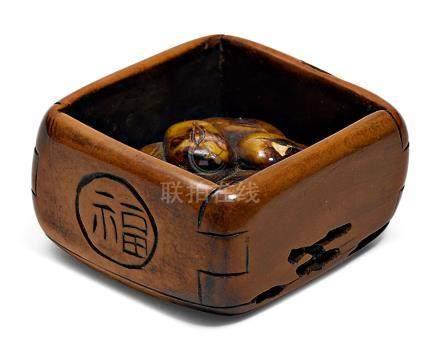 A BOXWOOD HAKO NETSUKE WITH BEANS FOR MAME-MAKI RITUAL.