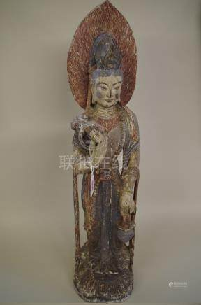 A Sino-Tibetan carved and polychrome painted wood figure,74cm high.