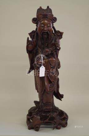 A Japanese carved wood figure,53.5cm high.