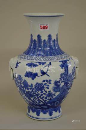 AChinese blue and whitetwin handled vase, Kangxi six character mark, painted with a phoenix and