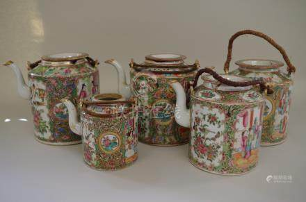 Five Chinese Canton famille rose wine pots,and four covers, largest 15cm high, (s.d).