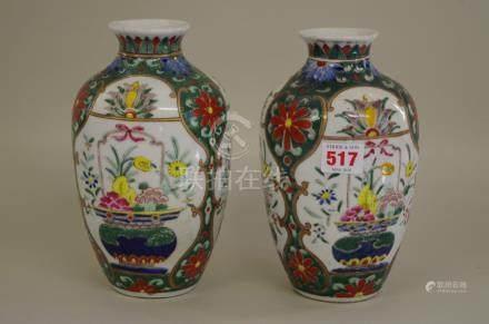 A pair of Japanese polychrome vases,21cm high.